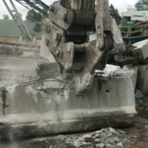 Concrete Freeway barriers being Pulverised By Capital Demolition